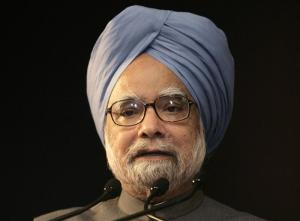 India's PM Singh speaks during India Economic Summit in New Delhi