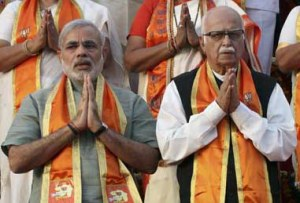 India's main opposition BJP leader Advani and Gujarat's Chief Minister Modi gesture during their party's election campaign in Ahmedabad